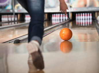 bowling with an orange bowling ball