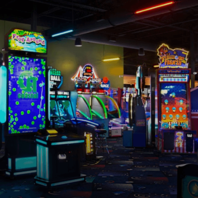 widespan view of arcade game room at stars and strikes