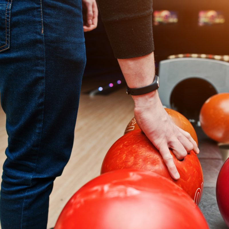 person picking up a bowling ball during the sunday night makes cents special