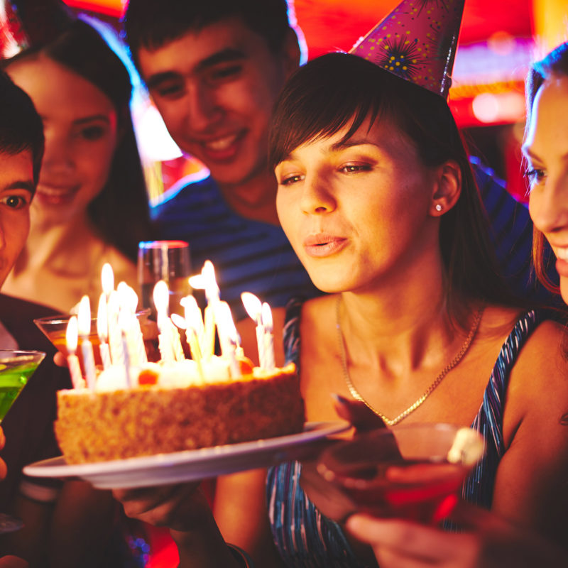 group of young people celebrating a teen birthday party