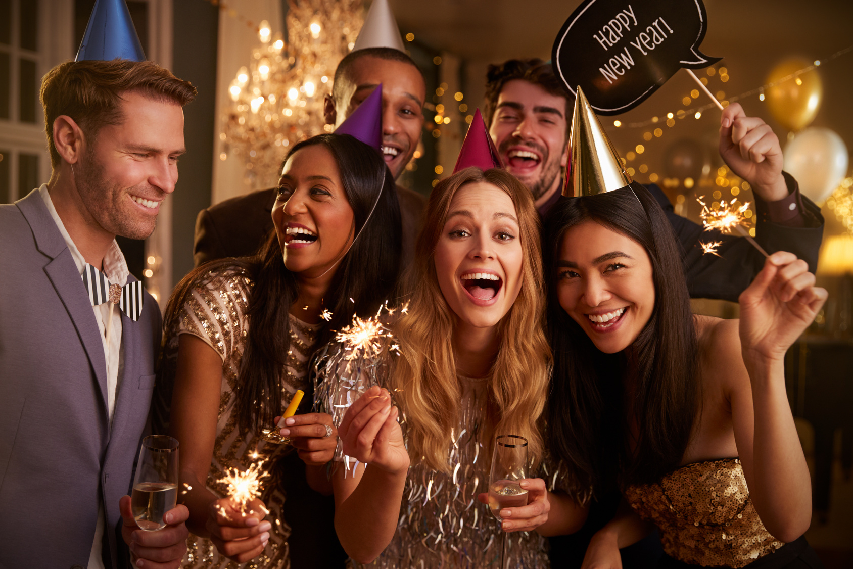 Group Of Friends Celebrating At New Year Party Together | Stars and ...