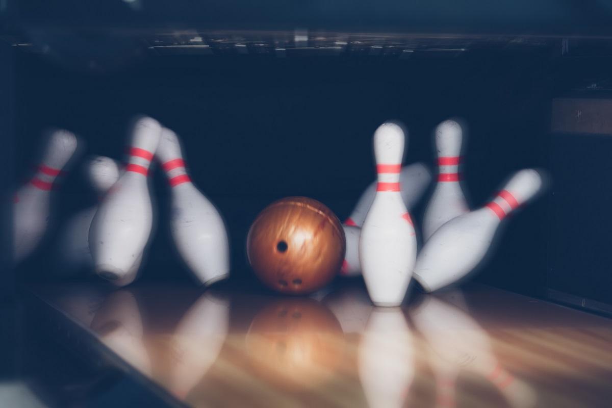 Ball hitting pins