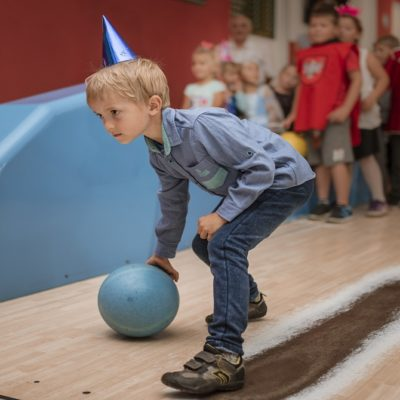 Child bowling at Summer Birthday Bowling Party