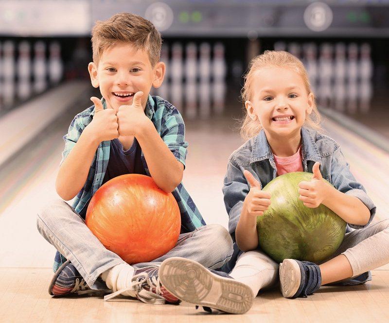 Kids Holding Bowling Balls