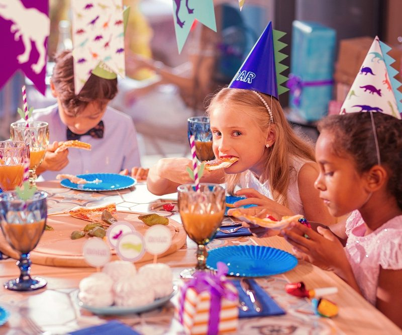 Kids Eating Pizza at a Birthday Party